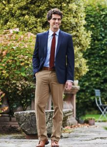 Man Wearing A Navy Slim Fit Chino Business Jacket And Beige Chino Trousers