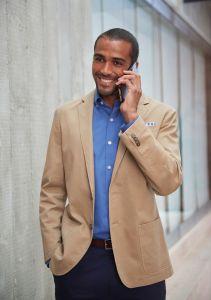 Man Wearing A Slim Fit Beige Chino Business Jacket