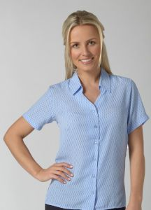 Woman Wearing a Navy And White Crepe Blouse With An Ellipse Print Design