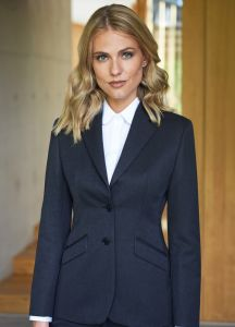 Woman Wearing A Navy Blue Two Button Business Jacket With A White Blouse
