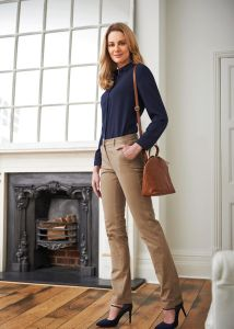 Woman Wearing A navy Blouse With Beige Slim Fit Business Trousers