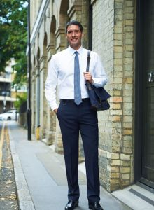 Man Wearing Navy Blue Tailored Fit Business Trousers With A White Shirt And Tie