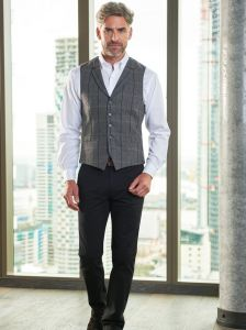 Man Wearing A Tweed Waistcoat and Black Chino Business Trousers