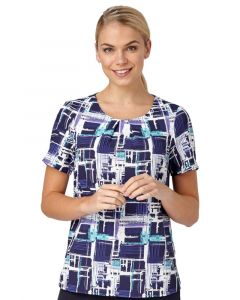 Woman In A Comfort Stretch Blouse With A Paint Print Design