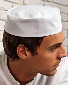 Man Wearing A White Turn Up Chefs Hat